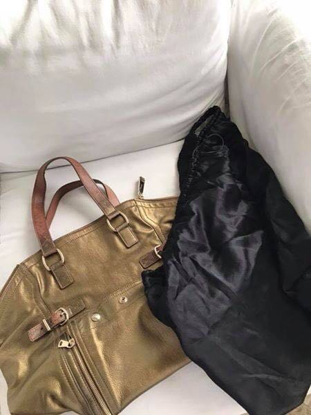 very good condition Authentic Ysl downtown with carecards and dustbag. Slight discoloration on handles only.