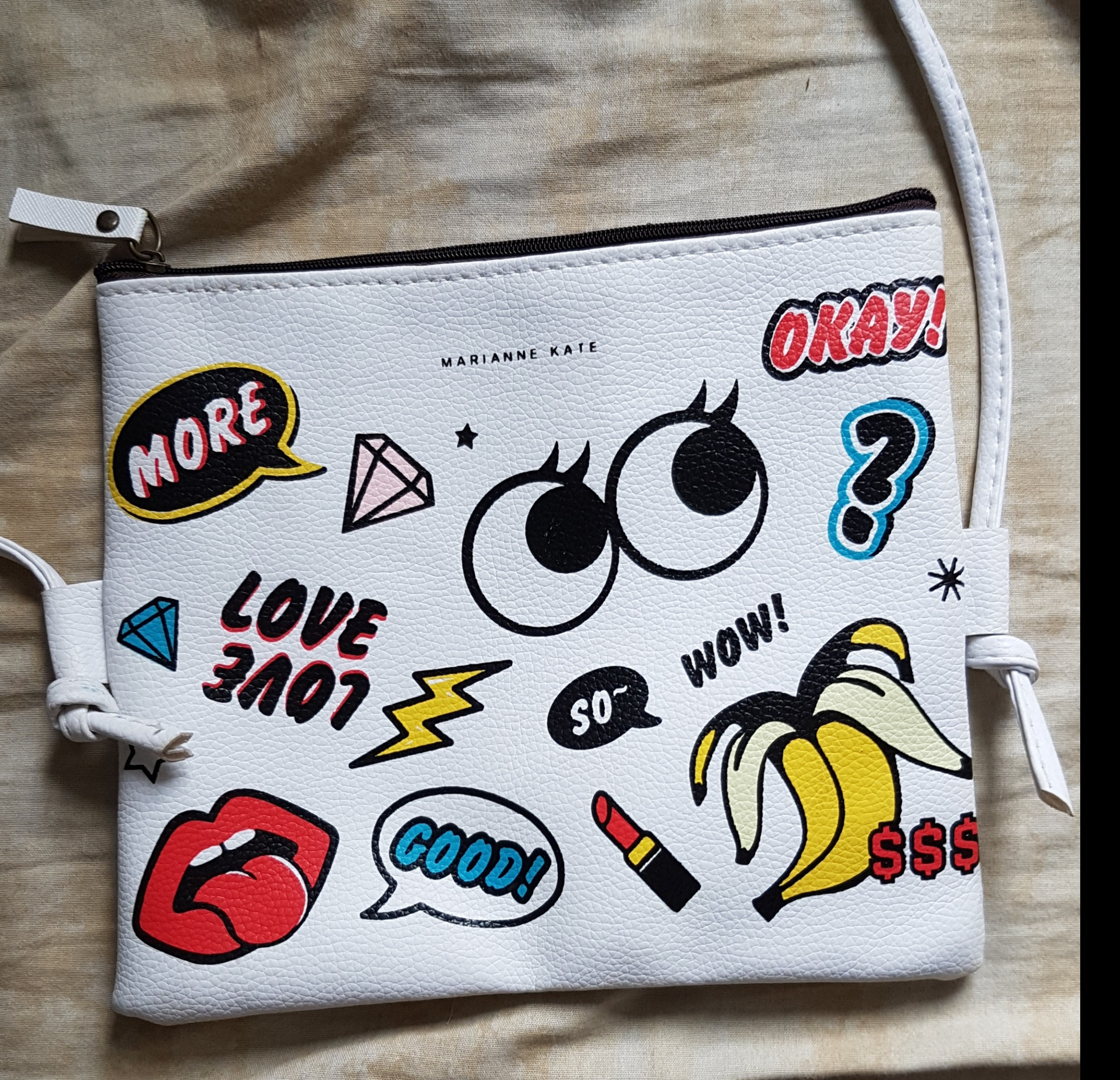 white cartoon sling bag