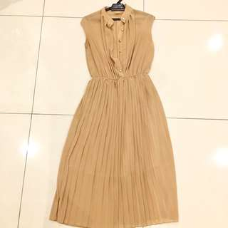 Light brown dress with gold buttons