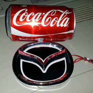 100%全新Mazda 着燈標誌,(連電線),3M自動強力膠貼,屯門交收,或4$郵寄。100% new. Mazda logo with light, trade in Tuen.Mun