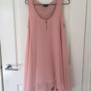 Pink flowy dress with intricate back detail