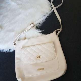 White bag with flower print inside