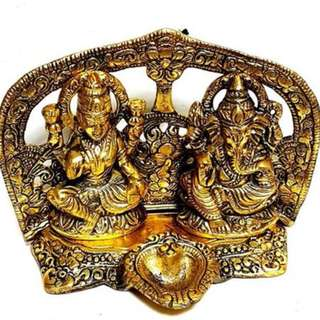 Golen statue of Godd n Goddess Laxmi Ganesha with Lamp
