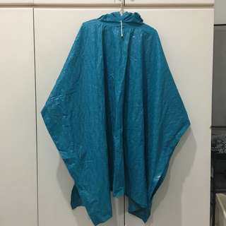 Raincoat brand new in turquoise