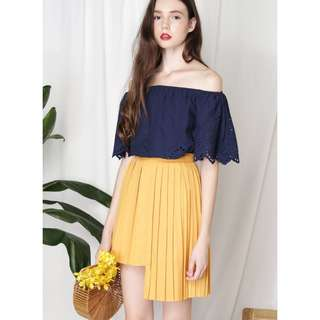 CRUSADE UNEVEN HEM PLEATED SKIRT (MARIGOLD)