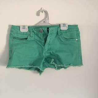 Green denim cutoffs