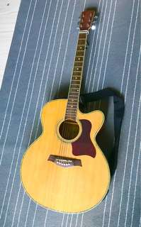 Pre-loved acoustic guitar