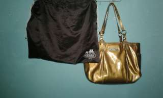 coach gold handbag