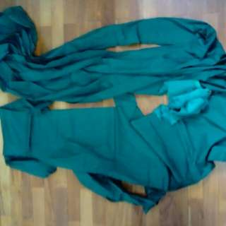 Irregular longish cuts of dark green cotton fabric