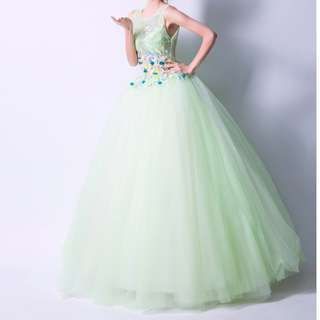 Green wedding gown with three-dimensional flowers