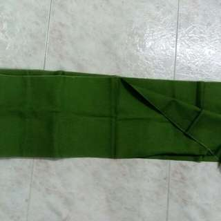 Textured dark green fabric strip