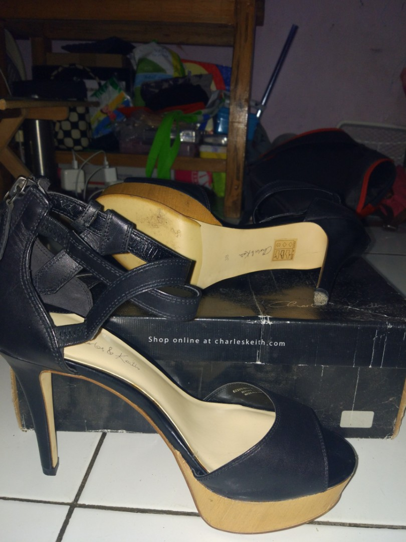 Charles and Keith signature label