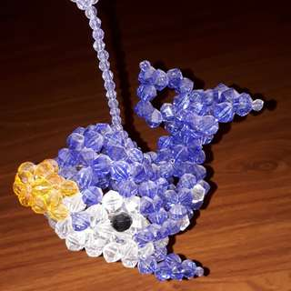 Blue and white handmade beaded whale