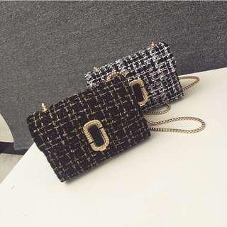Elegant Woollen Cross-body Bag with Metallic Strap