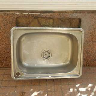 Stainless steel kitchen sink with granite counter top
