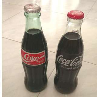 2 x Coca Cola glass bottles - one from Japan one from Thailand