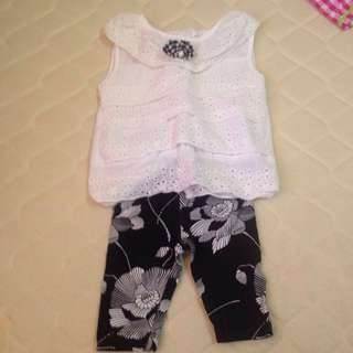 Set of black and white blouse and leggings