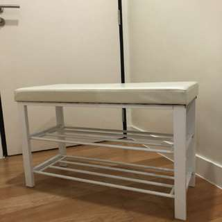 Shoe rack with seating cushion