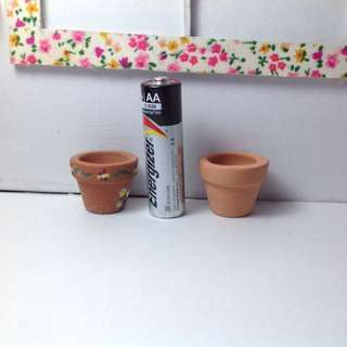 Tiny clay Pots