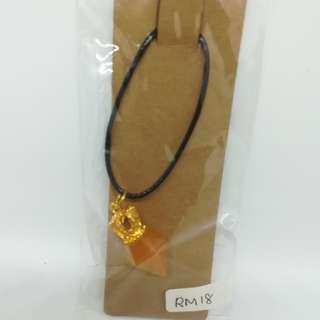Orange diamond with gold crown necklace