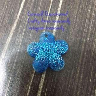 Blue glitter flower charm