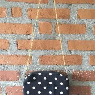 Polka sling bag