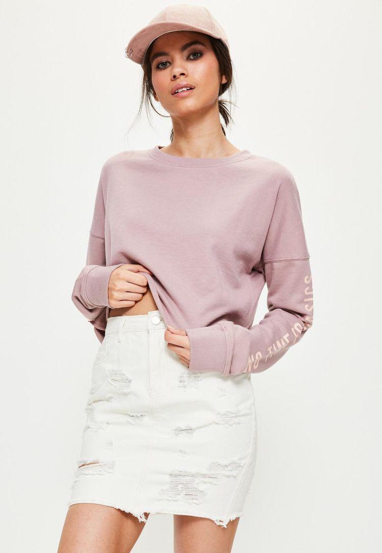 Cream distressed denim mini skirt