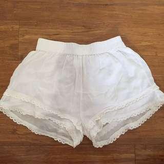 White loose shorts