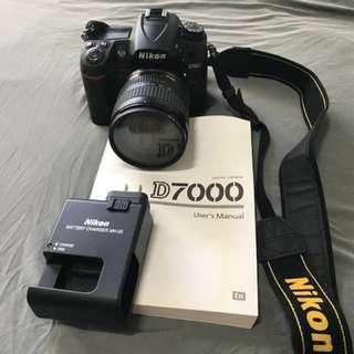 Nikon D7000 + Nikkor 18-70mm lens + Charger + Free camera bag