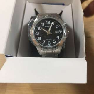 Casio women silver watch, with warranty card