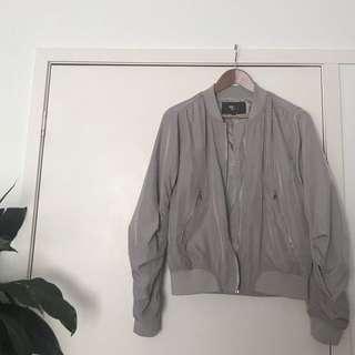 Grey bomber worn twice