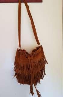 Women's brown tassel handbag