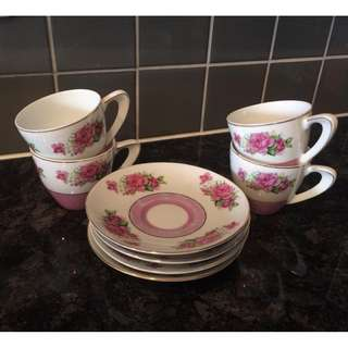Set of 4 teacup and saucers