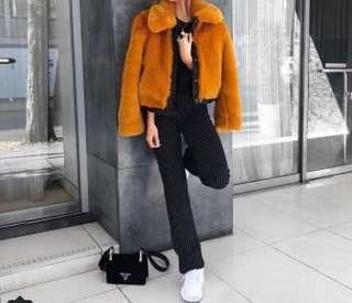 Orange fur coat size 4