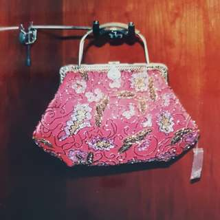 Brand new Beaded Bag. Comes with long sling chain.