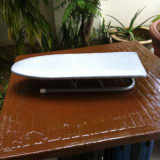 Small ironing board. 62 x 26 x 11cm. In good condition.