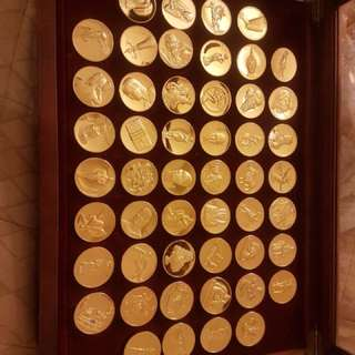 24 kt gold electro plated on bronze franklin mint coin