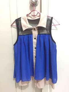 Blue sleeveless top with collar