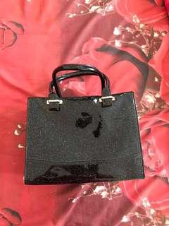 black glitery bag