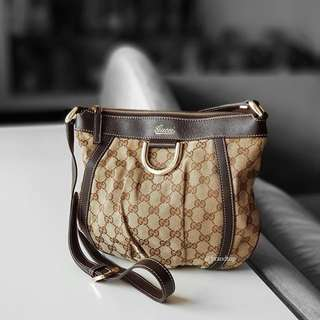 Authentic Gucci GG Canvas D Gold Crossbody Bag
