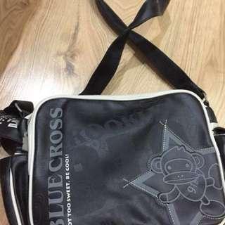 Blue cross kids sling bag