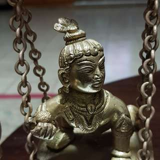 Baby Krishna on a Swing
