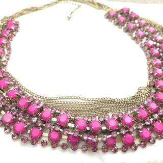 Chic multi-layered gold and pink chain necklace