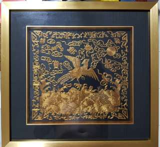 Frame - vintage hand sewn embroidery in gold thread.