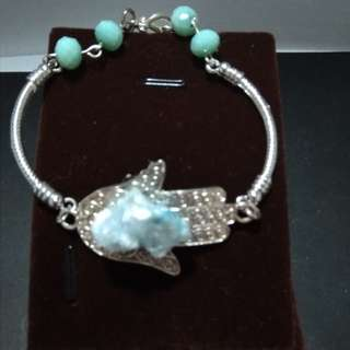 Silver bracelet with mint green beads and stalactite crystals
