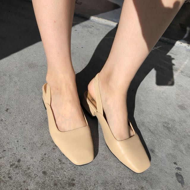 Beige slip shoes
