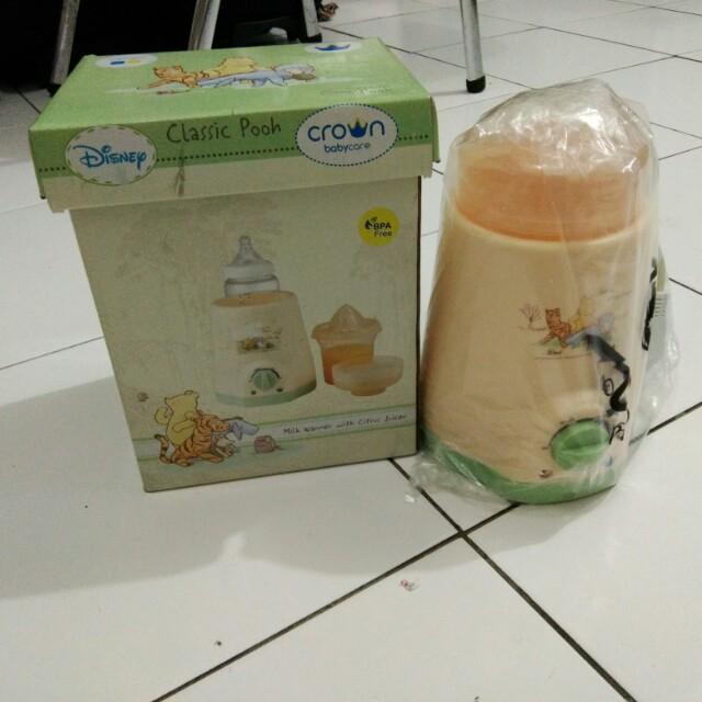 Milk warmer with citrus juicer