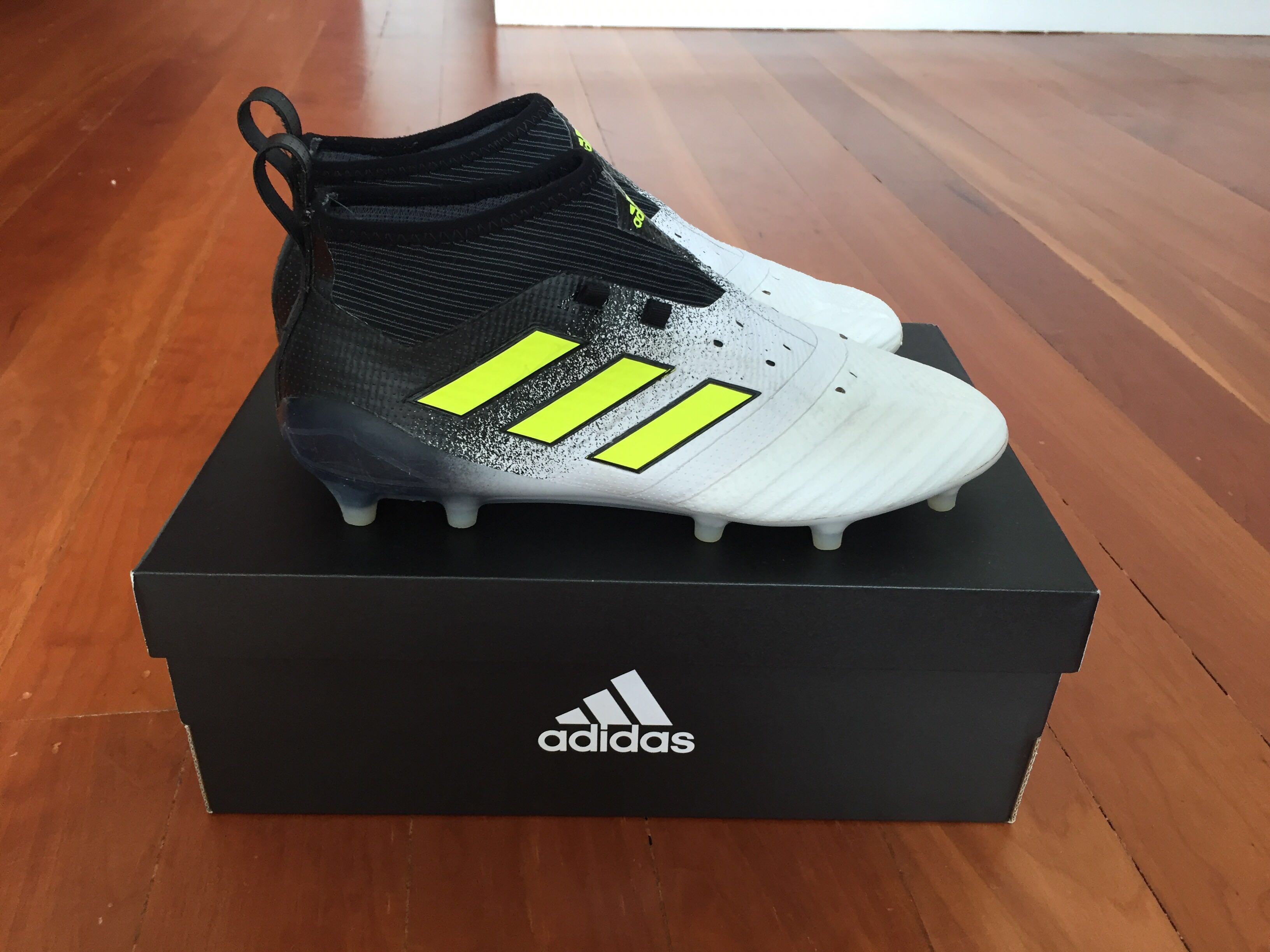 the latest db39b bc9b8 Professionally cleaned ACE 17.1 Firm Ground Boots- Black/White/Yellow