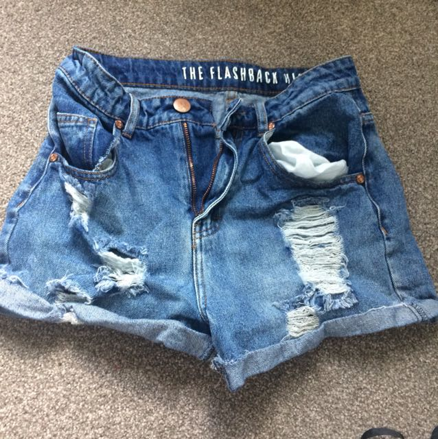 Ripped blue shorts