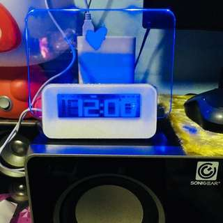Alarm clock with neon led memo pad/4 USB charging pod